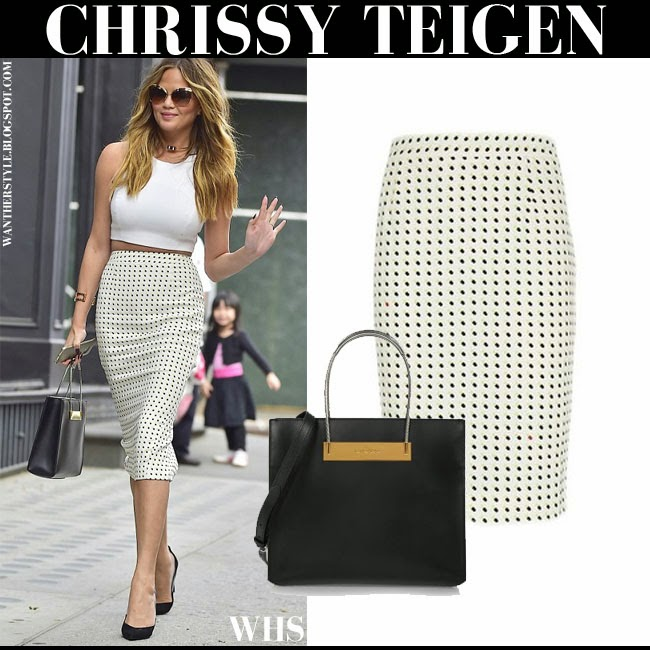 Chrissy Teigen in white polka dot print A.L.C. Happy pill pencil skirt with black balenciaga cable shopper tote what she wore may 12 summer spring city fashion