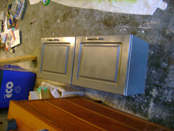 Painting the upper cabinets for over the recycling center
