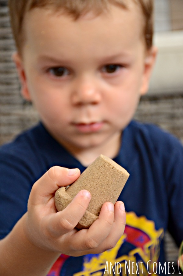 Making 3D shapes with kinetic sand and cups - fine motor sensory play for kids from And Next Comes L