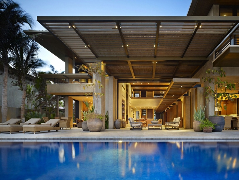 Swimming pool and terrace of Gorgeous modern stone house on the beach