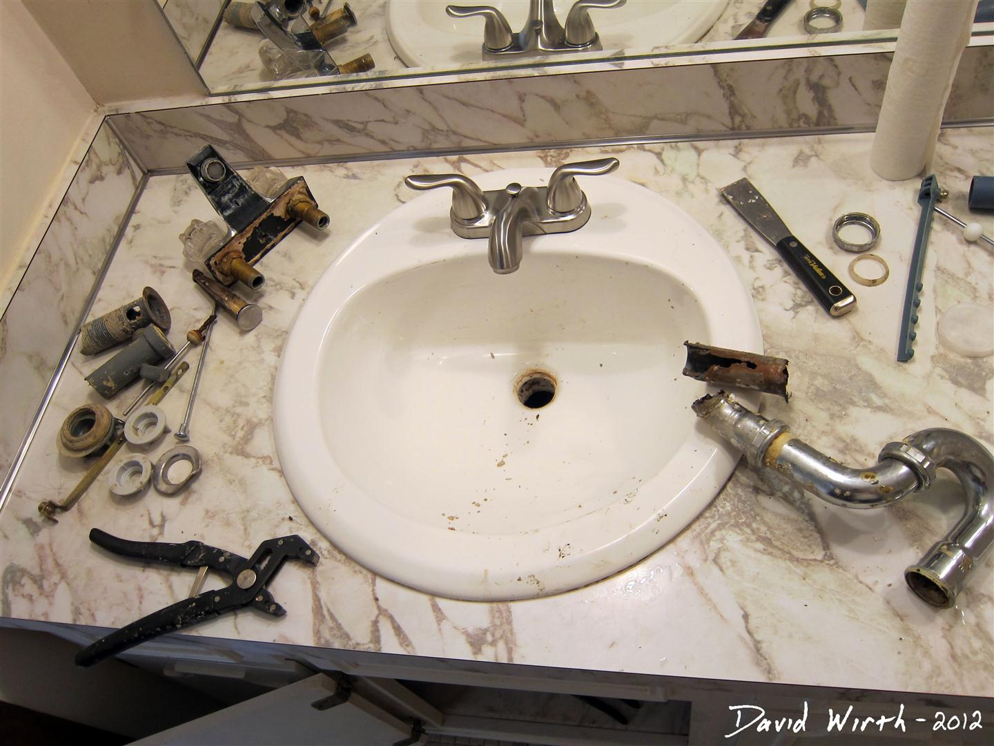 Bathroom sink how to install a faucet for Plumbing bathroom sink
