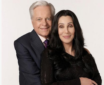 Cher cuddling up with Robert Osborne