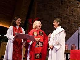 Women dressed as priests