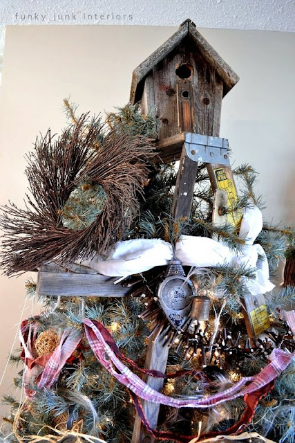 A rustic birdhouse as the star / The making of a stepladder Christmas tree, via : http://www.funkyjunkinteriors.net/