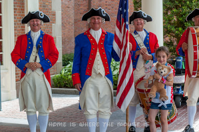 Bella poses with the Spirit of America Fife and Drum Corps at the American Adventure in Epcot