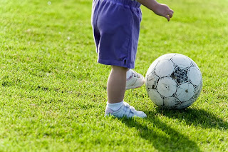 toddler playing football
