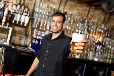 Bartender Offering Beer