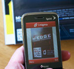 Image of QR code being scanned by a mobile phone.