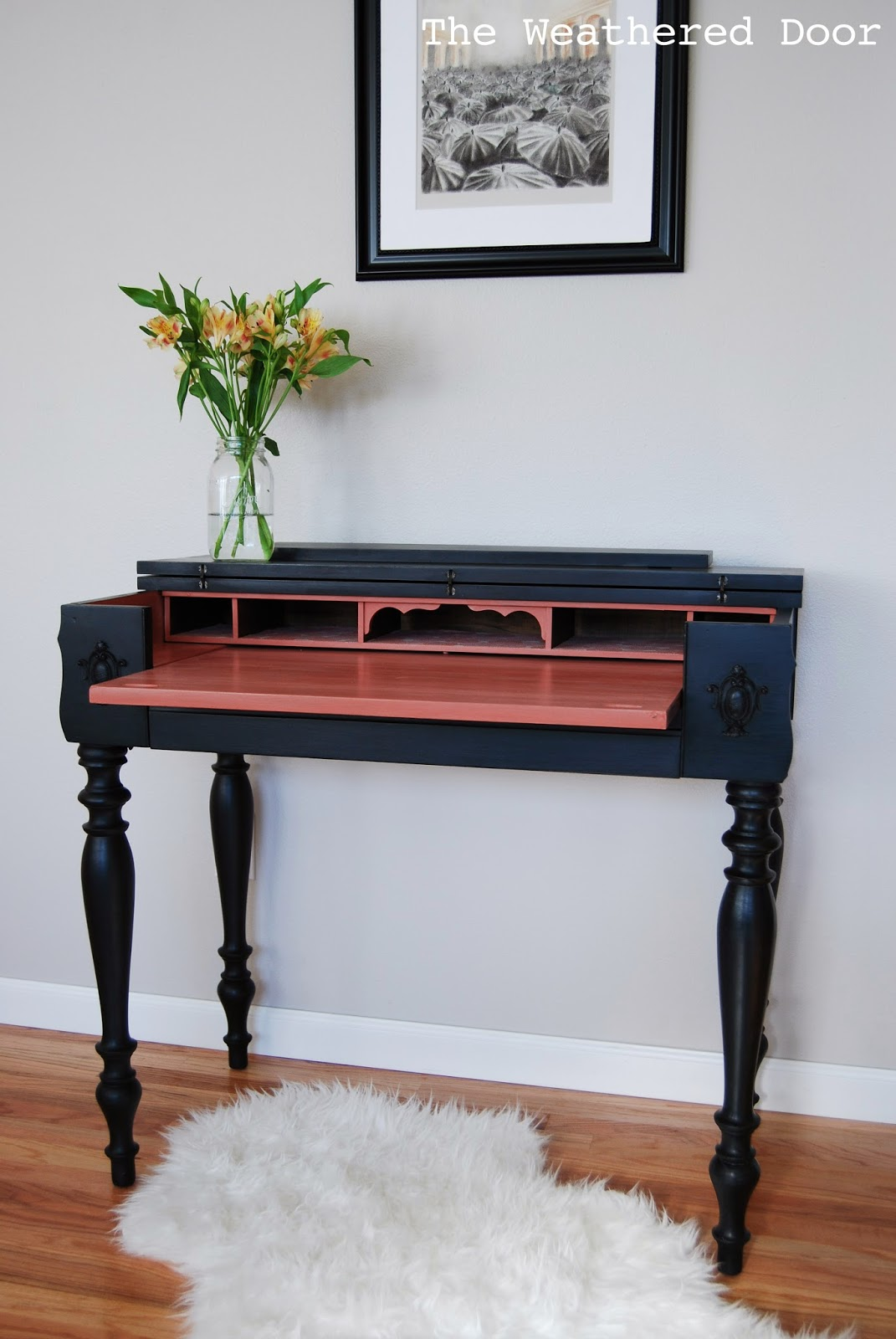 This beauty is one of my favorites which is mainly due to the fact that  she's a spinet desk. I love the versatility of these pieces, and those legs! - A Black And Salmon Spinet Desk - The Weathered Door