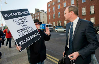 A protestor meets Minister for Agriculture Simon Coveney last week at Government Buildings in Dublin.