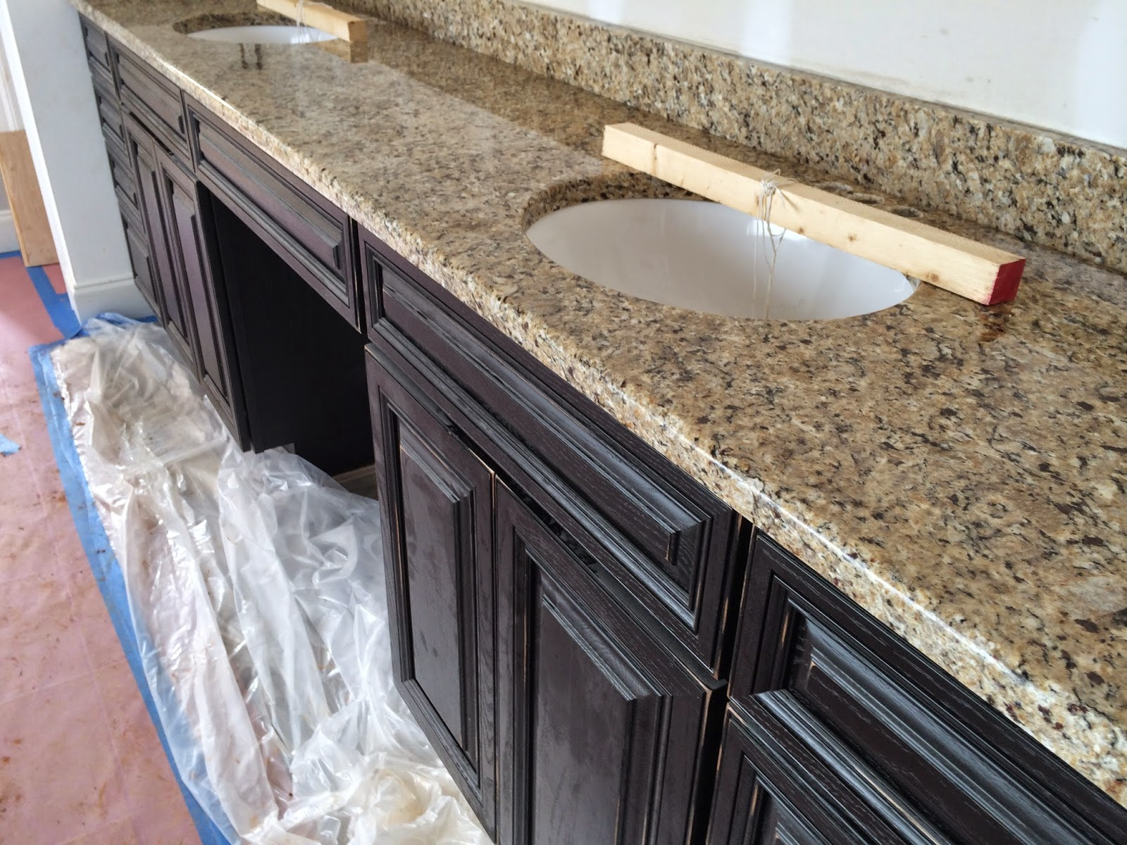 New Venetian Ice Granite, Distressed Black Cabinets
