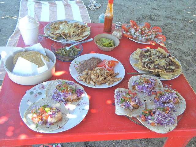 feast of beach food: baja fish tacos, shrimp tacos, lobster tacos ...