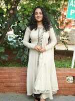 Nitya Menon New Glamorous photos at Ok Bangaram event-cover-photo