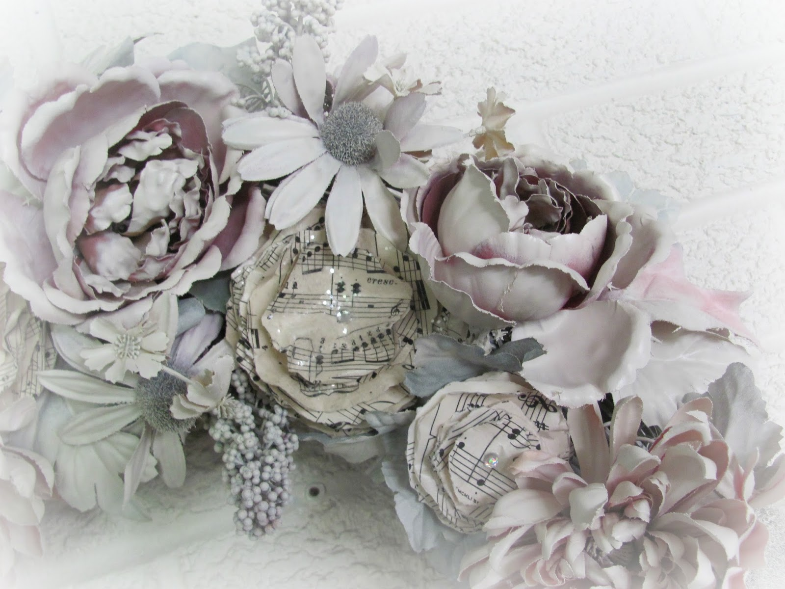 My shabby chateau spray painted wreath after the paint had dried i brought the wreath back inside and added the piece de la resistance a bunch of my glittered vintage sheet music roses mightylinksfo