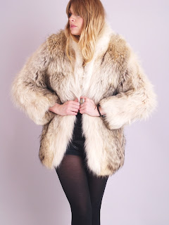 Vintage light brown coyote fur coat with scalloped hemline.