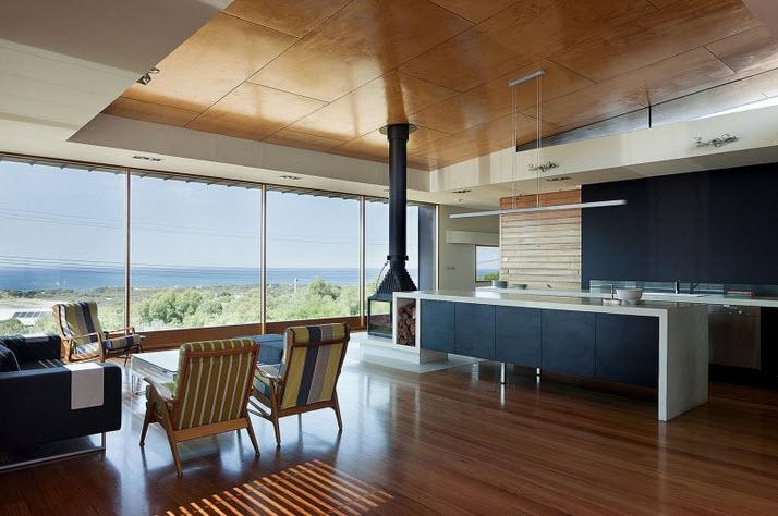 Dise o de casa de dos pisos moderna ubicada en pendiente for Diseno de la casa interior