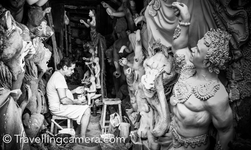 Recently I visited Kolkata and as told by blogger friends that it's best time to visit Kumartuli in the city. We spend half a day walking around the streets of Kumartuli and it's not only about Idol making, but much more than that. Localities of Kumartuli share a lot about Kolkata and it's cultural inclinations. This Photo Journey shares some of the photograph's clicked by TravellingCamera. Kumartuli is derived from Coomar-toli and now every Indian can make out the meaning. This place is residence of all artists who make Durga puja idols, which are used in different pandals of Kolkata and outside India.If you plan to visit Kumartuli and do photography, please ensure that you buy the ticket from committee office. A ticket costs 50 rs and then you can freely roam around. I found it a good practice. This way, committee also makes some money and as a photographer you are not scared that people would say weird things to you. I have had bad experiences shooting in old delhi and sort of scared clicking photographs in streets. Kumartuli photography is becoming popular and many of the great photographs have created masterpieces in the streets of Kumartuli.All the streets of Kumartuli are full of workshops where Durga Puja idols are made. Different families own these workshops and almost all of them have different styles of making these idols. At a basic level, all these idols look similar except sizes. But when they start doing minor changes for final finishing, one can make out the clear difference.There are different stages to the whole process making Durga Puja Idols. On Akshaya Tritiya, clay for the sculptures is collected from the banks of Ganges. A handful of soil (punya mati) is collected from the nishiddho pallis of Calcutta, where sex workers live and adding it to the clay mixture which goes into the making of the Durga sculpture.After the required rites, the clay is transported. An important event is 'Chakkhu Daan', literally donation of the eyes. Starting with Devi Durga, the eyes of the sculptures are painted on Mahalaya or the first day of the pujas. Before painting on the eyes, the artisans fast for a day and eat only vegetarian food.Kumartuli history is very interesting. When East India Company decided to build new settlement Fort William at the site of the Gobindapur village, many existing population shifted to Sutanuti. Neighbourhoods like Jorasanko and Pathuriaghata became the centres of the local rich. Separate districts were allotted to the Company's workmen - Suriparah for wine sellers, Collotollah for folks dealing in oil, Chuttarparah became carpenters hub, Aheeritollah - cowherd's quarters and Coomartolly  for potters. Now potters of Kumortuli make gods and goddesses, worshipped in large numbers in the mansions all around and later at community durga pujas in Kolkata and outside the country.Streets of Kumartuli are most busy from the month of August till October, although artists start getting orders in April. Most of the artists of Kumartuli are busy throughout the year and they get orders from different parts of the worlds.When I talked to one of the artists of Kumartuli, he told us some interesting facts about Durga Puja and it's preparations. It seems that different streets of Kolkata have different pandal for Durga puja and a contest is run in whole city. Best Durga-Puja Pandals are given prizes and local media remains focussed on these activities.Not very sure, but it seems that artists of Kumartuli don't earn much. Like many other businesses in India, middle men earn One of the artist mentioned that some of the artists visit them during different stages of idol making and ensure that idols are made as per their choice. Such clients know well about this form of art and have valid comments most of the times. We could some of the such clients who were there to ensure that things are working fine or to suggest changes.It was a brilliant experiences to walk through the streets of Kumartuli. At every 5 steps, you see a new workshop working on different kinds of Durga idols. And these streets tell you much more about Kolkata and not only about the idol making process.While walking thought the streets of Kumartuli, we were wondering about the state of these Artists. It seemed that most of these artists dwell in poor living conditions. There are some popular families in KUmartuli who have been doing this for many years. Popular among them are Mohan Banshi Rudra Pal, his sons Sanatan Rudra Pal and Pradip Rudra Pal, Rakhal Pal, Ganesh Pal, Aloke Sen, Kartik Pal, Kena Pal, who are still reigning figures of Kumortuli. The good part is that most of the major clients come to these families who better know the art of idol creation.Women are not lagging behind. Kumortuli boasts of the presence of some 30+ women artisans, like Minati Pal, Soma Pal, Kanchi Pal and Chapa Rani Pal. They have been in the business of idol making for a long time. For more, check out this link. Some of the workshops were working on few project but huge in scale. Their style and details were also unique. Check out the photograph above and the one shared below. Look at the the details in these photographs.Have a closer look at this photograph and garland. This garland is made up of hundreds of art-pieces you see in the photograph below.Most of these artists have to work late-night during August-Oct. Some of these artists get lot of orders and they need to work extra to accomplish them with good quality.Some friends from Kumartuli :) . One of them was following us after we clicked this photograph. She used to stop as we look back.When main structures are in shape, heads, fingers and other detailed pieces are added.Some of the workshops had already started the coloring process, which is one of the final steps of idol making process.