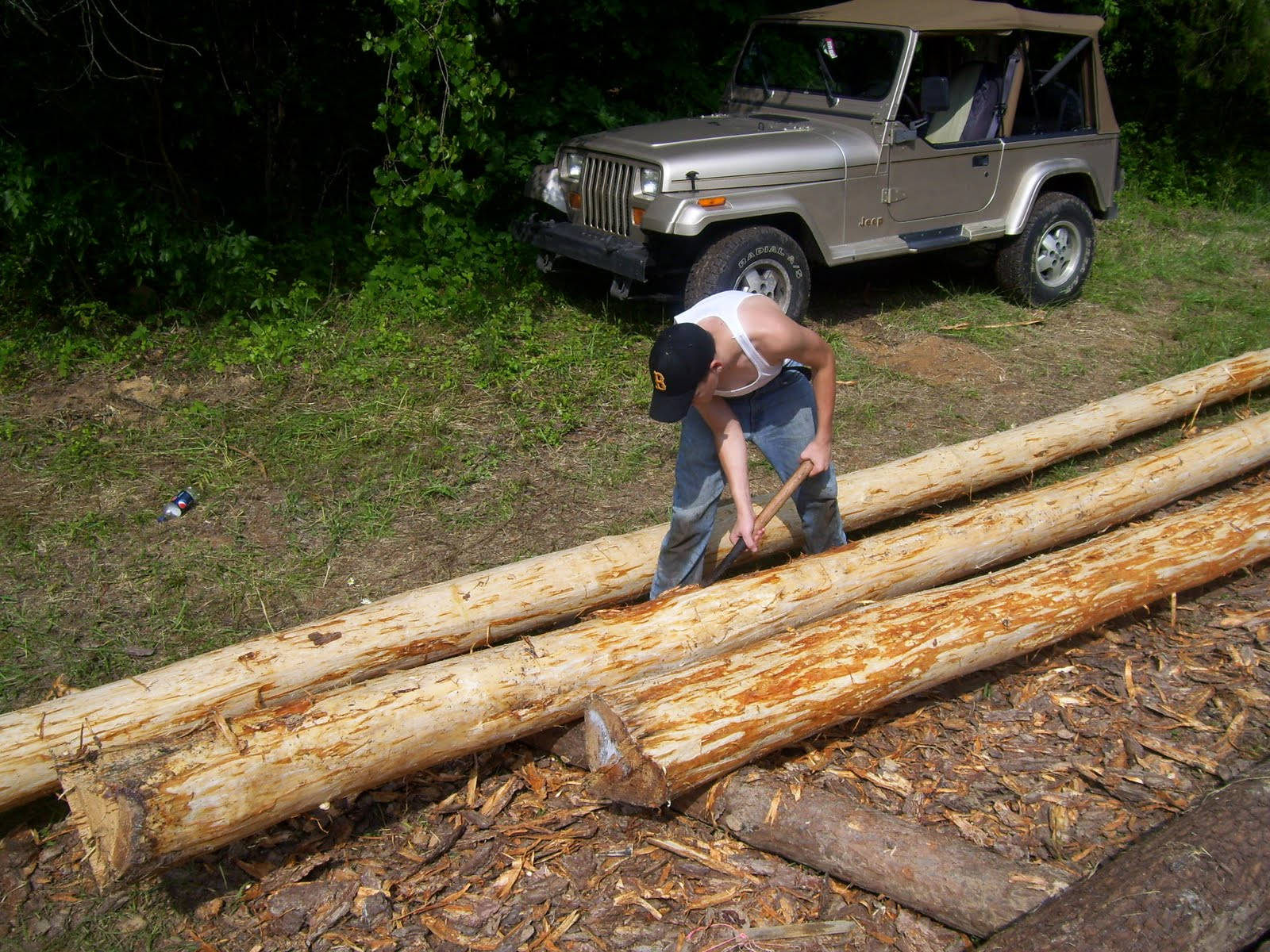 Building a butt and pass log cabin peeling some racked How to build a butt and pass log cabin