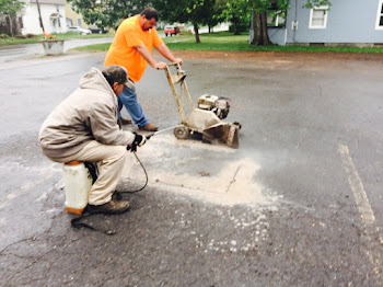 Crew from Marzano Paving Remove Metal from Pavement