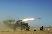 Syrian armed forces fire a missile during a live ammunitions exercise in an undisclosed location December 4, 2011