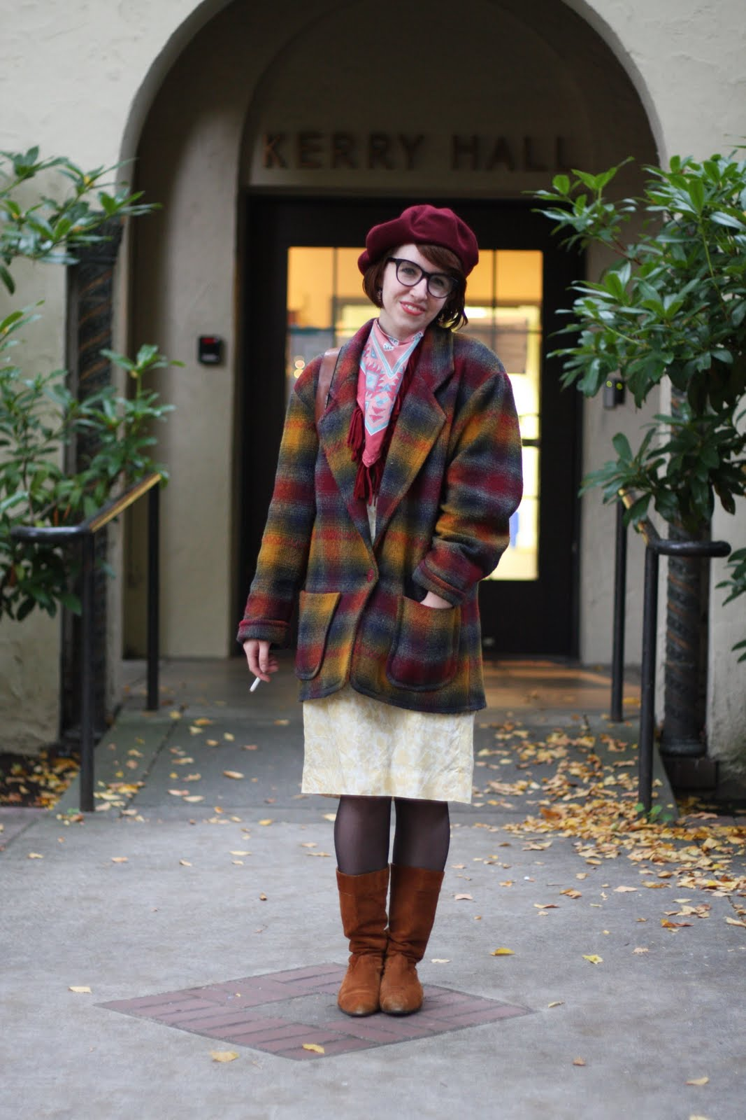 Cornish Art Institute in Seattle, WA student wears a rainbow tweed herringbone coat over a white dress and brown boots