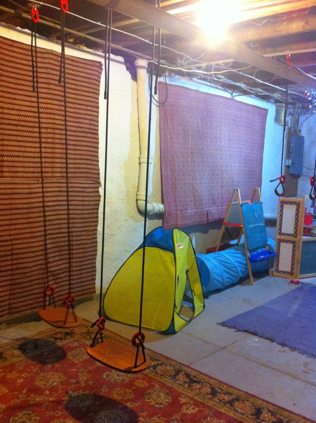 out some space in our very unfinished basement for a play area