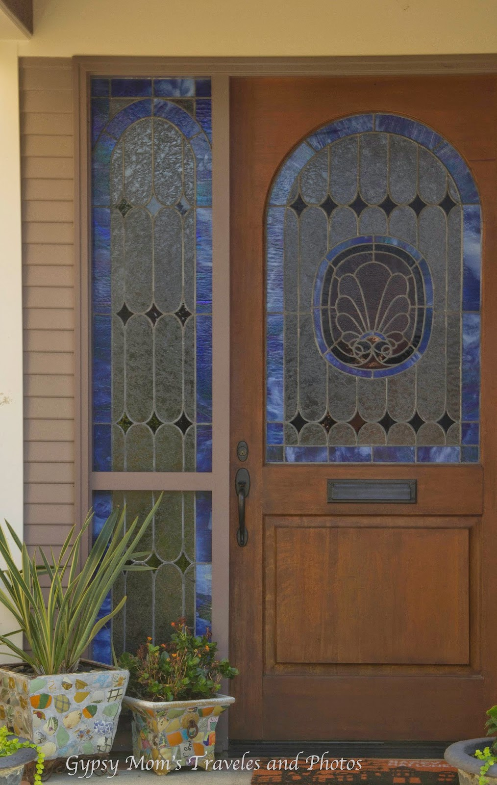Stained glass front door and window on one of the floral streets in Corona del Mar