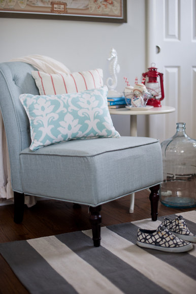 This comfy blue chair pairs well with the patterned accent pillows.