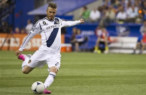 Los Angeles Galaxy player David Beckham scores from a free-kick against Montreal Impact