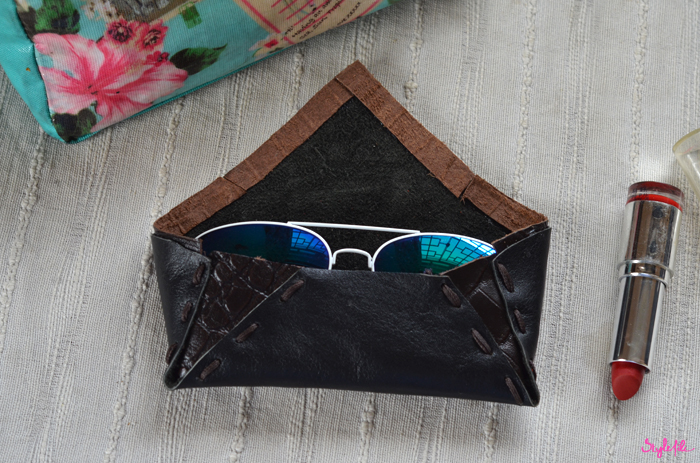 For the Hidesign Art of Reuse contest, Dayle Pereira of Style File handmade a sunglasses case with crocodile embossed leather panels, stitching and a matching trim which can be seen with reflector aviators, lipstick and tropical prints