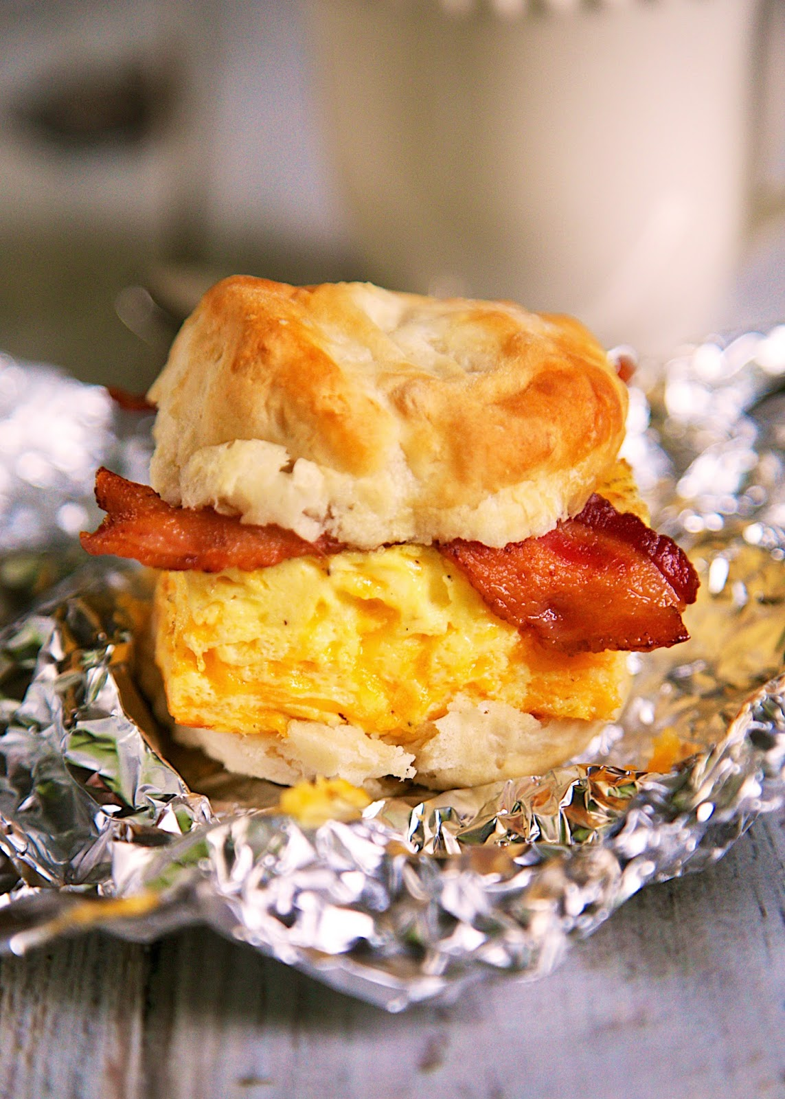 Biscuit Sandwich With Cheddar Spread, Canadian Bacon, And A Fried Egg ...