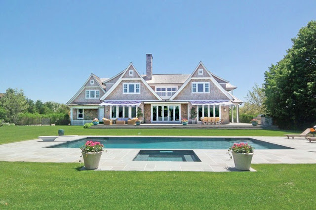 exterior photo of the backyard and pool of a house in the Hamptons