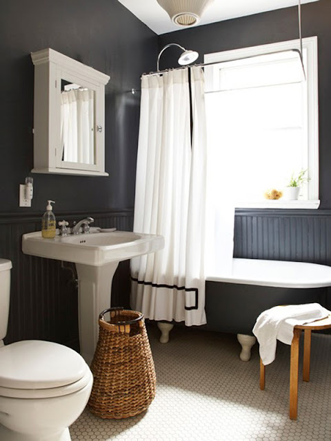 am absolutely loving the idea of black walls in a bathroom.