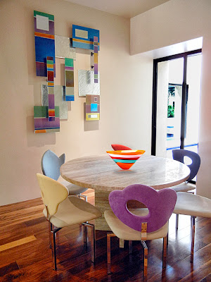 trendy and fun dining room design with pops of colors as well as attractive wall decoration