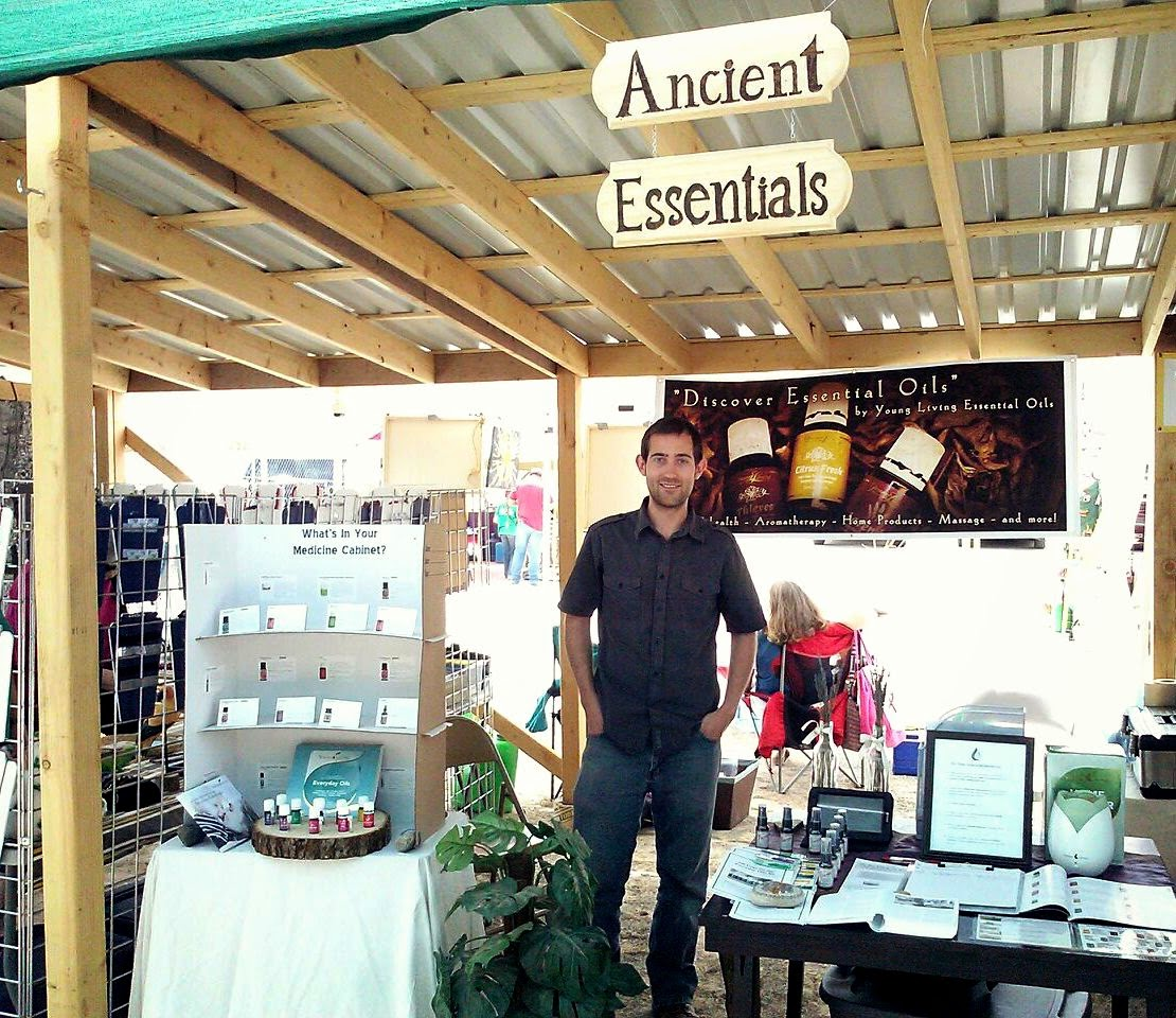 My husband at our essential oils booth.