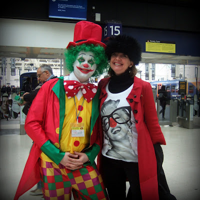 Sophie Neville at Waterloo Station making a donation to Comic Relief on Red Nose Day