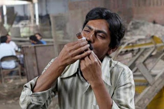 Nawazuddin Siddiquii as Faisal Khan, Smoking Marijuana, Directed by Anurag Kashyap