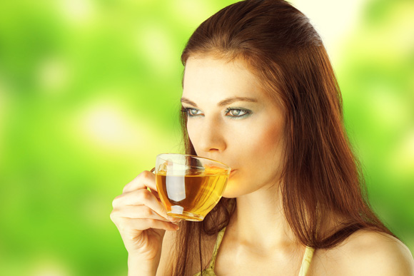 Young female Drinking Tea For Weight loss