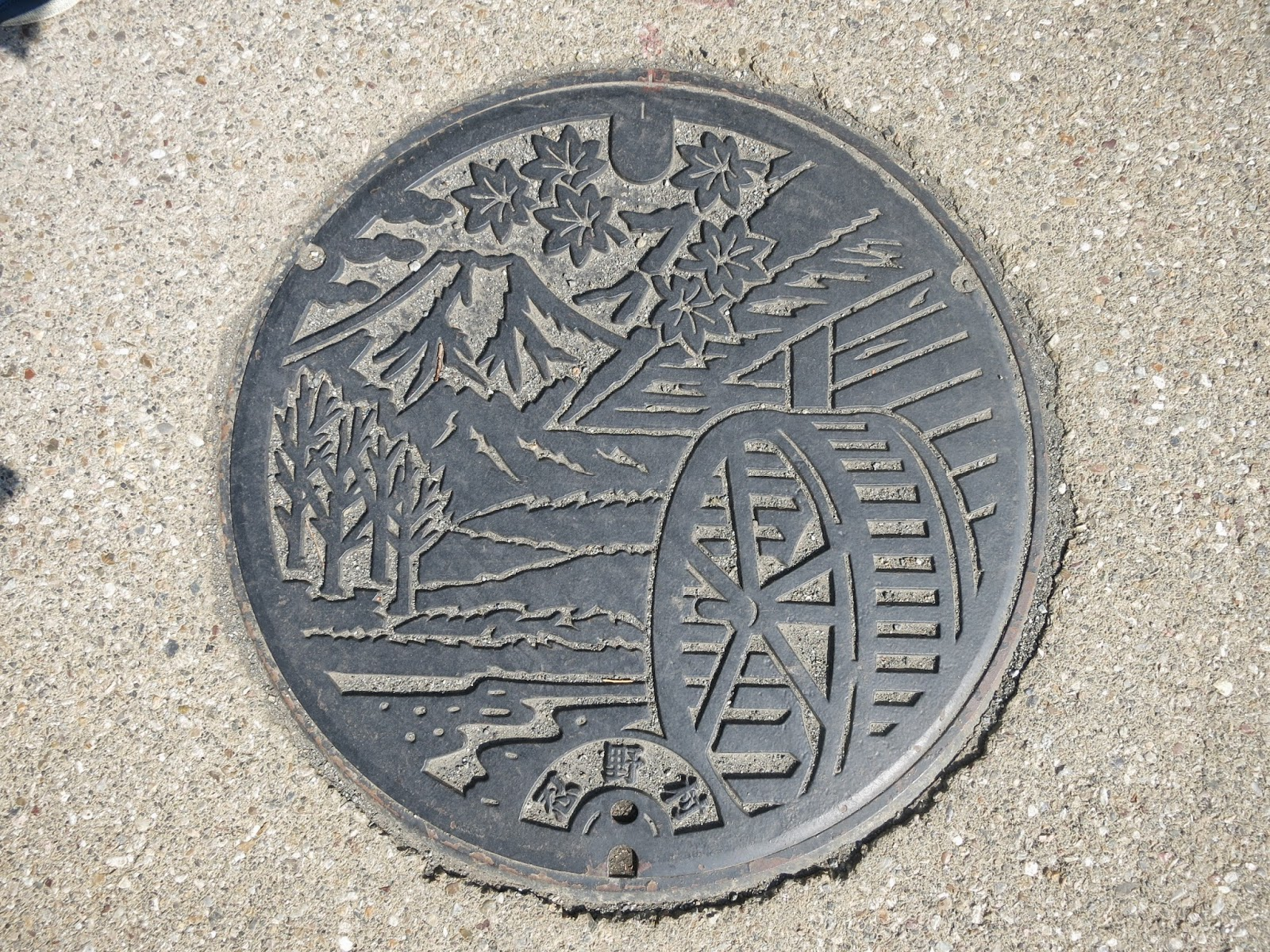 Splash of Yellow: Why do the Japanese have nice manholes?
