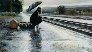 Girl-waiting-alone-in-rain-near-railway-tracks-lost-love-image.jpg