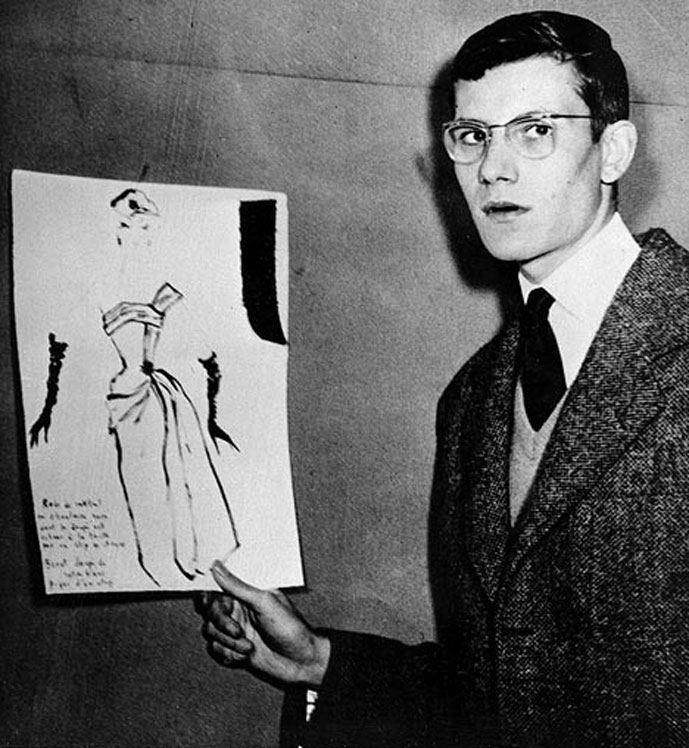 Yves Saint Laurent holding a sketch on 11 December 1954