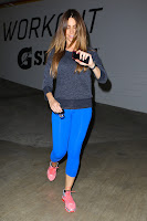 Sofia Vergara in blue tights and pink sneakers