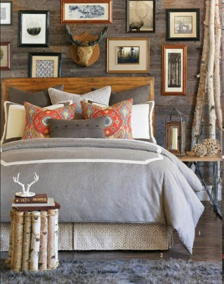 i really like this hodgepodge wall of old black and white photos and engravings above the bed and the way it contrasts with the clean modern bedding