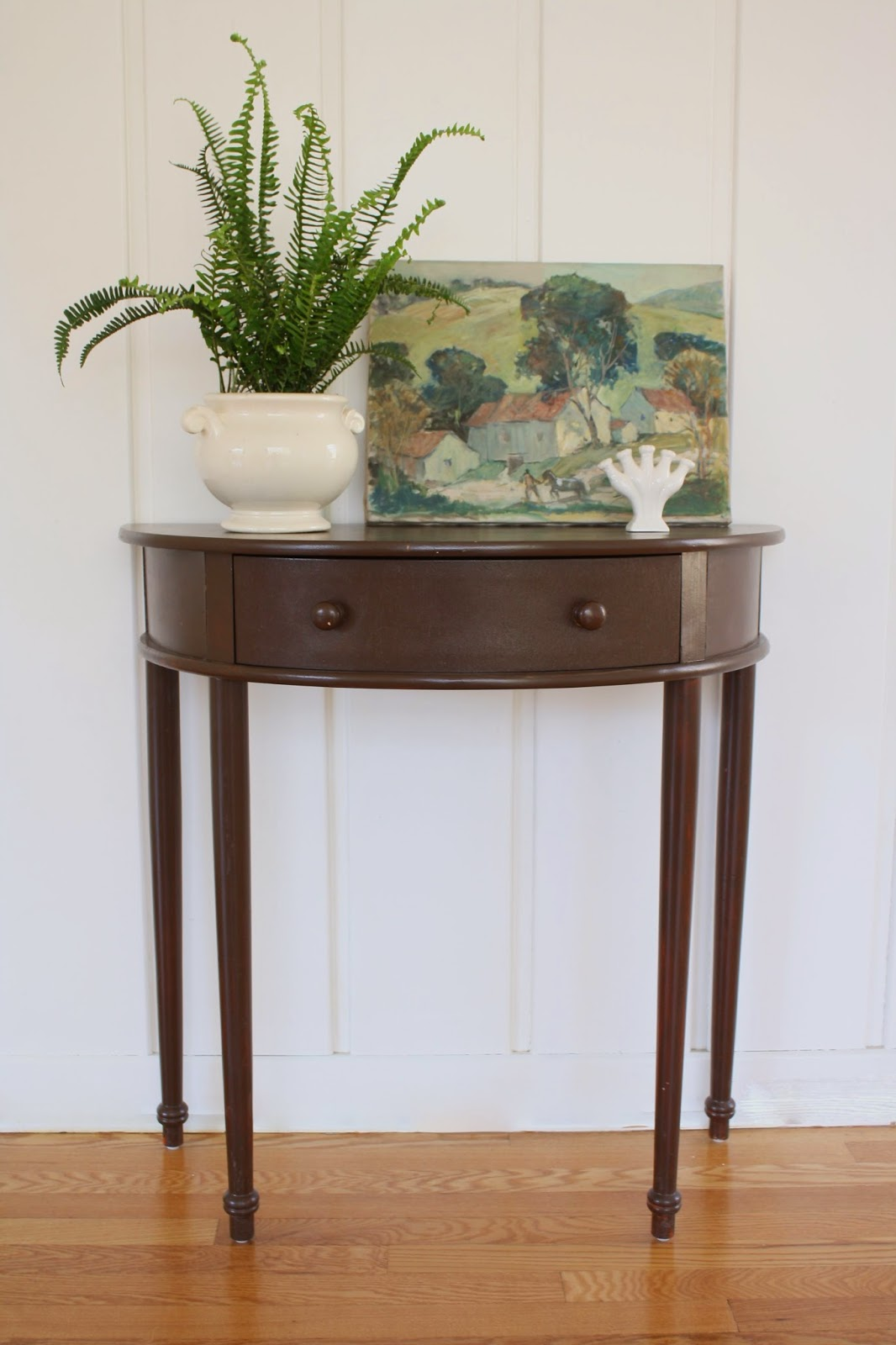 thrifted demilune table via Meet Me in Philadelphia