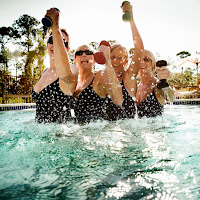 Elder women doing aqua-cise with weights