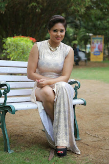 Nikesha Patel in Tight full length leg Split gown at Narathan Press Meet