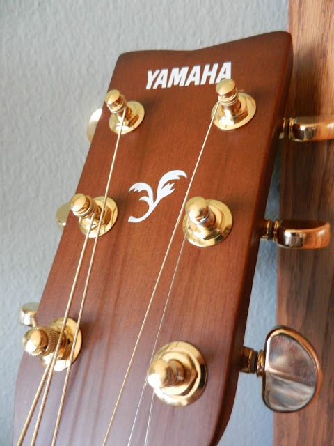 yamaha honey colored guitar