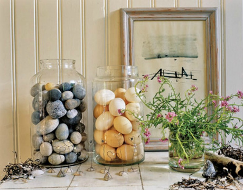 glass jars filled with rocks and eggs