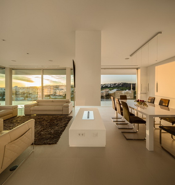 Minimalist interiors in Modern Villa Escarpa by Mario Martins