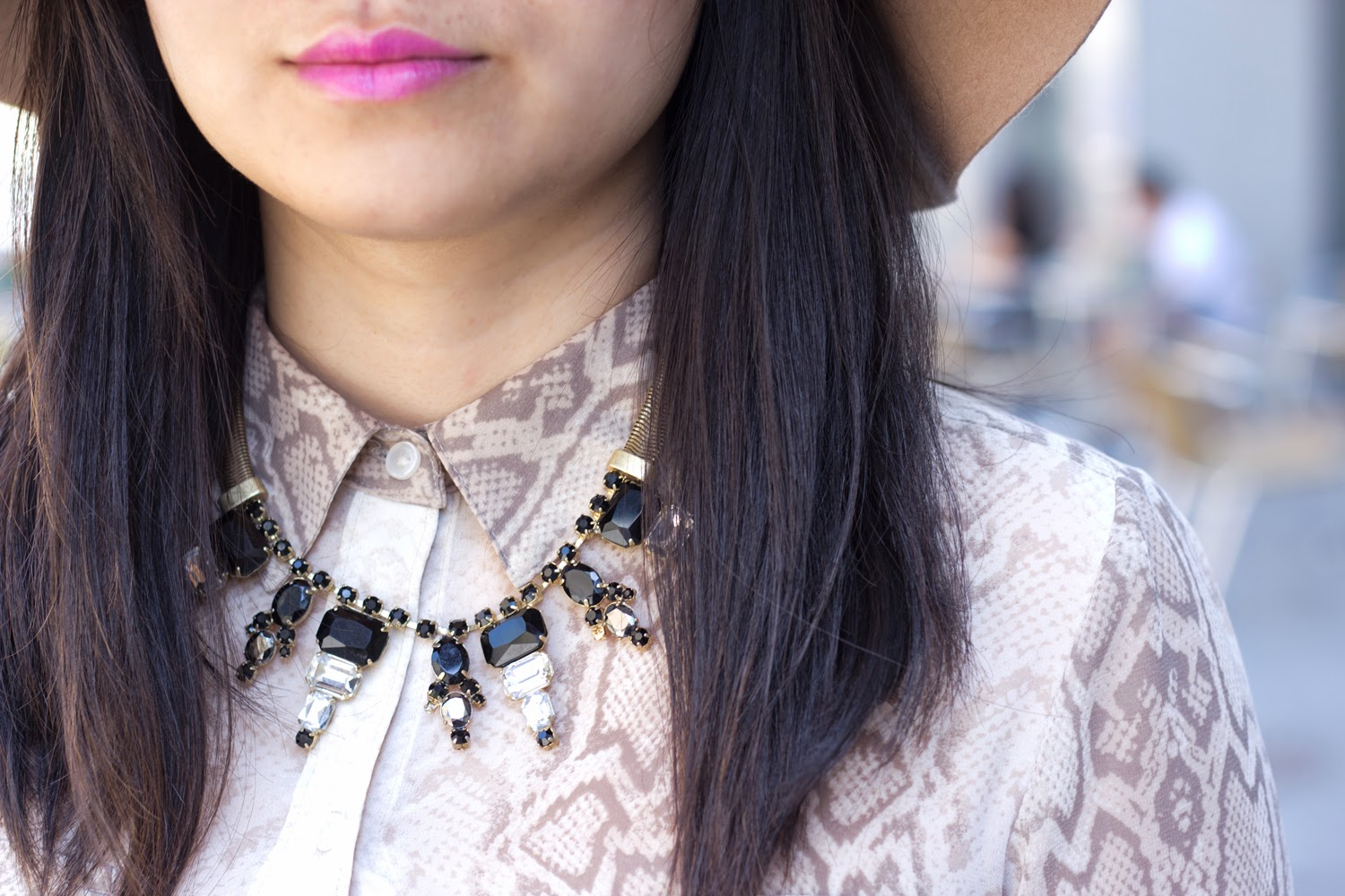 purple-pink-lipstick, statement-necklace, snake-skin-print-blouse